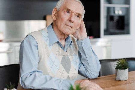 Photo for Upset pensive elderly man at home during quarantine - Royalty Free Image