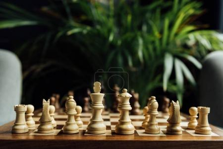 Photo for Closeup view of chess set on chess board. Selective focus on white chess figures - Royalty Free Image