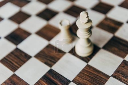 White chess figures on chess board