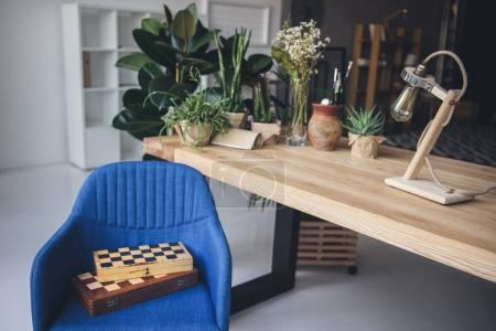 Artistic workplace with chess boards