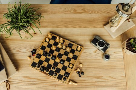 Chess game with vintage camera