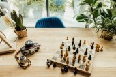 Workplace with chess set on chess board