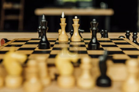 Photo for Side view of black and white chess pieces on chessboard during the game - Royalty Free Image