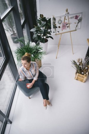 businesswoman with coffee in office