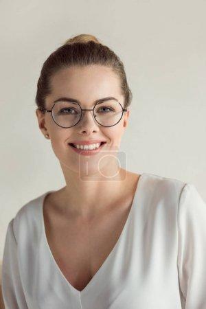 stylish businesswoman in eyeglasses