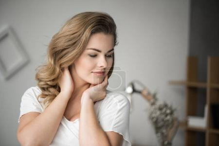 Photo for Portrait of charming blonde tender woman in white clothes - Royalty Free Image