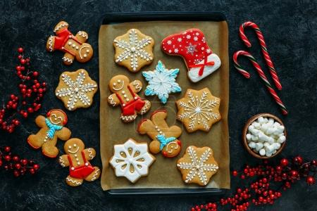 Top view of homemade gingerbreads on baking tray w...