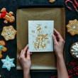 Cropped view of hands with homemade gingerbreads a...