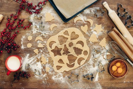 Photo for Top view of unbaked dough for christmas cookies on wooden table - Royalty Free Image