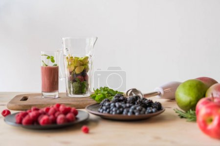 Photo for Close up view of various fresh ingredients for detox drink on wooden tabletop - Royalty Free Image
