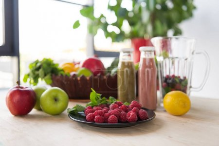 Photo for Close up view of detox drinks and healthy food on table - Royalty Free Image