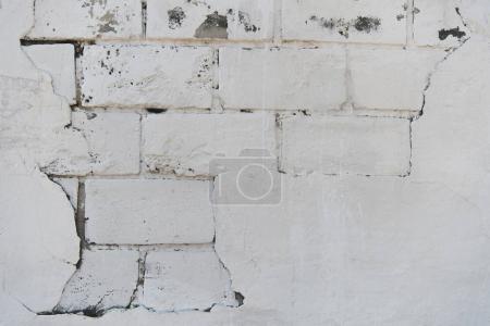Photo pour Vue rapprochée de la texture blanche du mur de briques altérées - image libre de droit