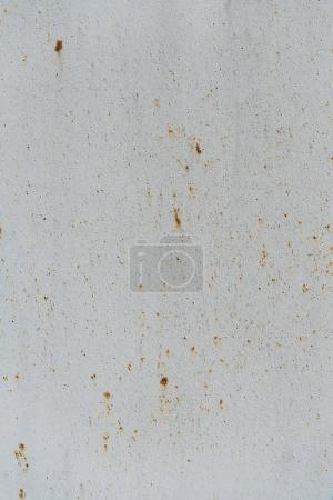 white surface with rust