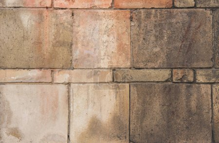 Photo for Close-up view of weathered brick wall textured background - Royalty Free Image