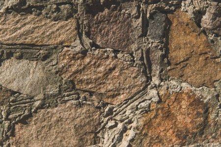 Photo pour Vue rapprochée de la texture du mur de pierre brune - image libre de droit