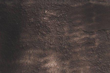 Photo pour Vieux mur sombre altéré fond texturé - image libre de droit