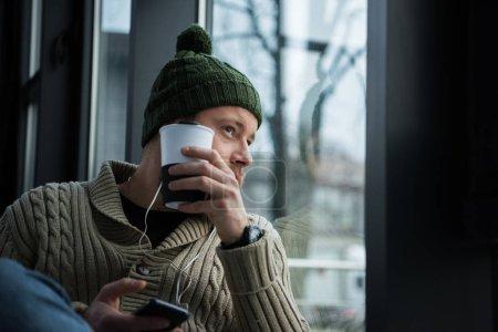 man looking at window