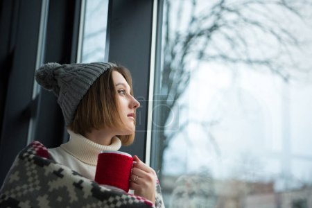 girl holding red cup