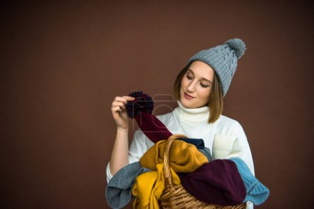 woman taking hat