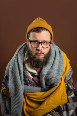 Man wrapped in scarfs