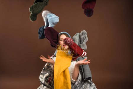 Woman throwing up winter hats