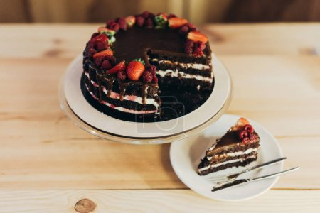 Photo for Piece of delicious cake with fruits on a plate - Royalty Free Image