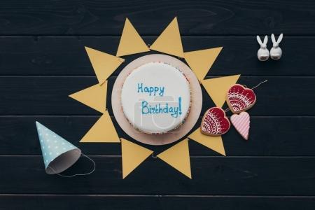 triangular paper garland and birthday cake