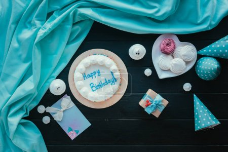 birthday cake with present and sweets
