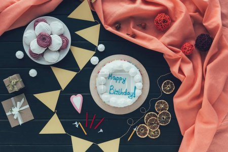 Photo for Top view of creamy birthday cake on a wooden table - Royalty Free Image