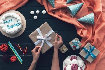 woman opening present box