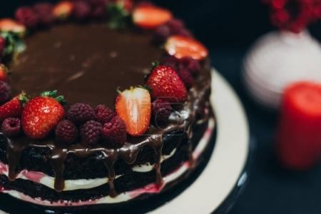 Photo for Chocolate cake with strawberries and raspberries - Royalty Free Image
