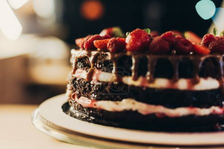 chocolate cake with cream and fruits