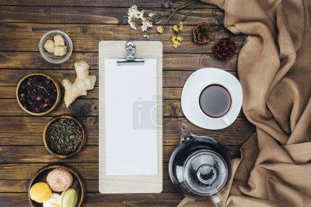 tea set and blank clipboard