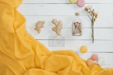 Photo for Top view of ginger and macaroons on wooden table - Royalty Free Image
