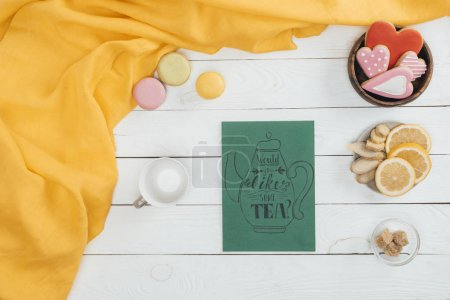 Photo for Top view of tea card and delicious cookies with empty cup on wooden table - Royalty Free Image