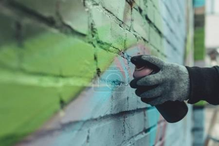 Photo for Cropped view of man painting colorful graffiti on wall - Royalty Free Image