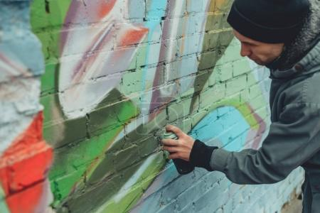 Photo for Street artist painting colorful graffiti on wall - Royalty Free Image