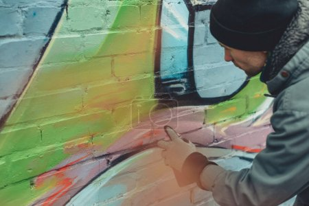 Photo for Man painting colorful graffiti on wall - Royalty Free Image