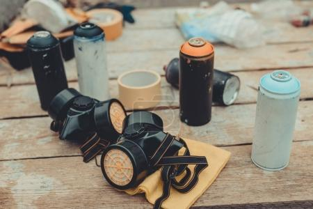 respirators and cans with colorful spray paint for graffiti
