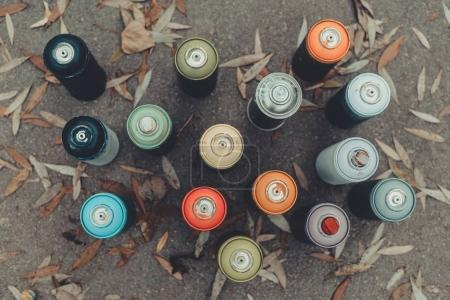 top view of cans with colorful spray paint for graffiti