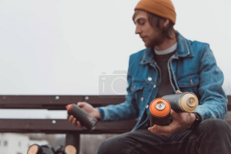 Photo for Male street artist holding cans with spray paint - Royalty Free Image