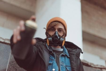 Photo for Selective focus of man in respirator holding can with spray paint - Royalty Free Image