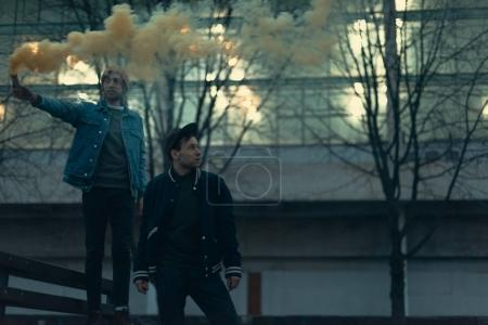 Photo for Young men with smoke bomb in city - Royalty Free Image