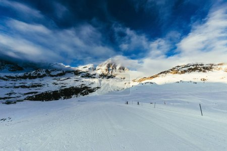 ski track on beautiful mountains landscape under blue sky, Austria
