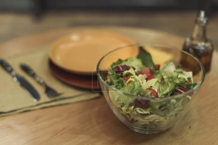 selective focus of freshly made vegetables salad in bowl on table