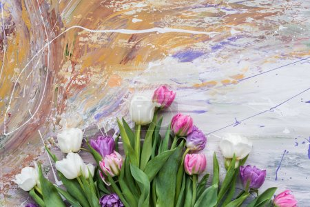 Tender spring tulips on stained background