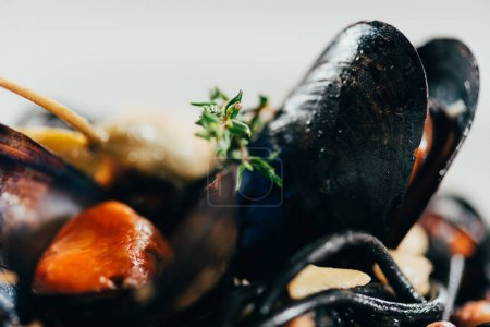 Photo for Selective focus of delicious spaghetti with cuttlefish ink, squid and mussels with octopus - Royalty Free Image