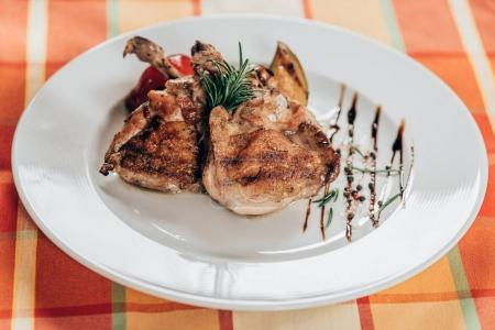 delicious grilled chicken with rosemary and sauce on plate