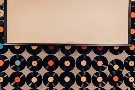 top view of background made from vinyl records and blank frame