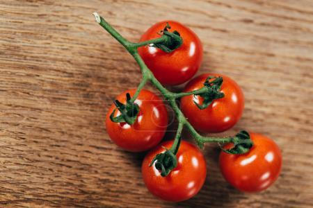 Photo for Top view of fresh ripe cherry tomatoes on wooden table - Royalty Free Image